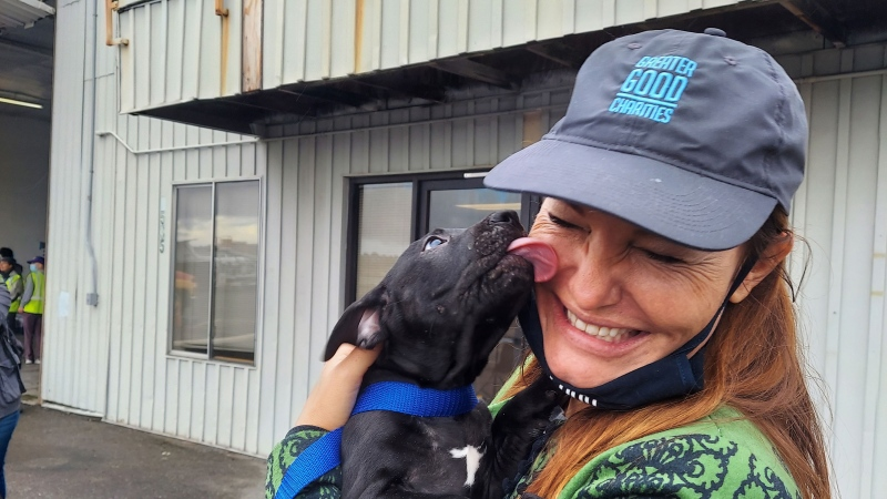 Liz Baker, CEO of Greater Good Charities, with her newly adopted dog Hilo. (Greater Good Charities)