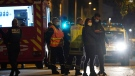 Police officers work at the scene after a Greek Orthodox priest was shot Saturday Oct.31, 2020 while he was closing his church in the city of Lyon, central France. (AP Photo/Laurent Cipriani)