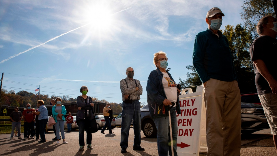Early voters line up outside of the Vienna Community Building to cast their ballots for the Nov. 3 election. (Stephen Zenner/AFP/Getty Images)