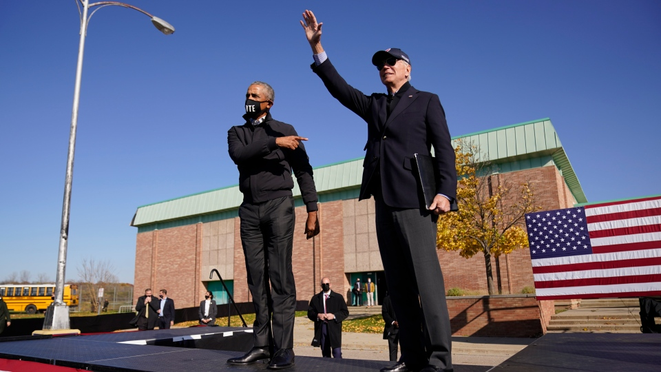 Democratic presidential candidate former Vice President Joe Biden, right, and former President Barack Obama greet each other at a rally at Northwestern High School in Flint, Mich., Saturday, Oct. 31, 2020. (AP Photo/Andrew Harnik)237