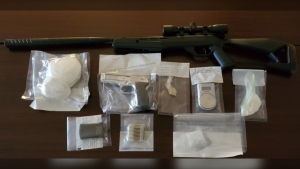 On Friday, N.B. RCMP executed a search warrant at two apartments in a single complex on Main Street – seizing an undisclosed quantity of drugs, drug paraphernalia, two pellet guns and ammunition. (Courtesy: New Brunswick RCMP)
