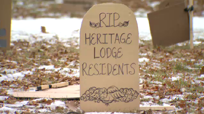 Protesters placed tombstones in front of the premier's house Friday night. (Source: CTV News/Dan Timmerman)