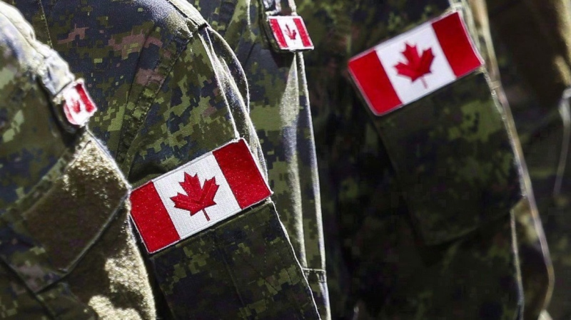 Members of the Canadian Armed Forces march during the Calgary Stampede parade in Calgary on July 8, 2016 in this file photo. The Defence Department says Master Warrant Officer Guy Adam Law was found dead in his quarters at the Canadian Embassy in Kabul on Feb. 25. THE CANADIAN PRESS/Jeff McIntosh