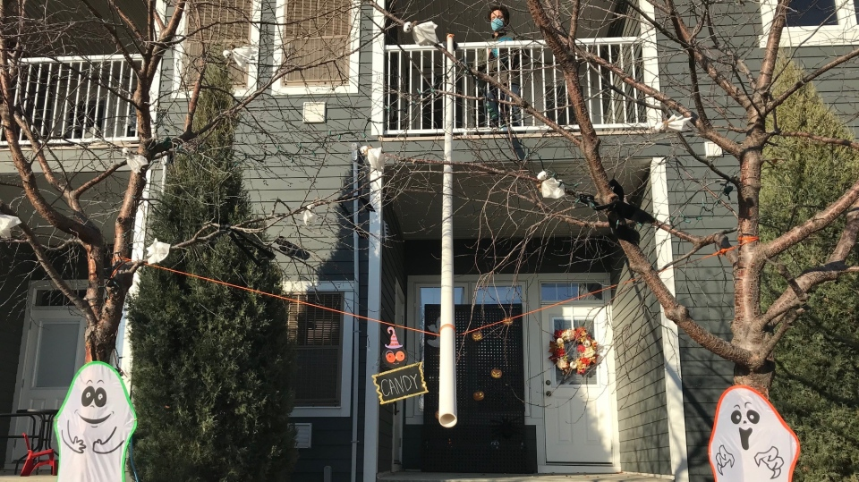 Neighbours Keane Baseden and Breanna Fradette created this two-storey chute to dispense candy safely on Halloween. (Stefanie Davis/CTV News)