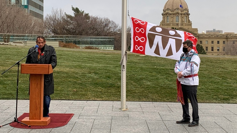 Metis Settlements General Council (MSGC) President Herb Lehr takes the podium from Indigenous Relations Minister at the MSGC flag-raising on Oct. 30, 2020. (Government of Alberta)