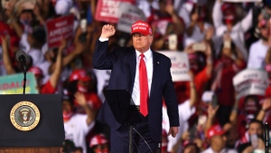U.S. President Donald Trump leaves his campaign rally at Opa-Locka Executive Airport, early Monday, Nov. 2, 2020, in Opa-Locka, Fla. (AP Photo/Jim Rassol)