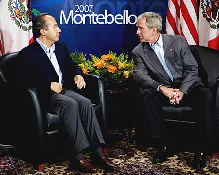 U.S. President George Bush speaks with Mexican President Felipe Calderon at the start of a bilateral meeting at the North American Leaders Summit in Montebello, Que. on Monday, Aug. 20, 2007. (AP Photo/CP, Adrian Wyld)