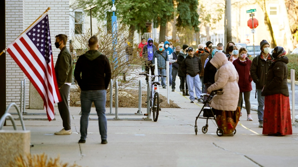 Voters wait to cast their votes on Election Day, Tuesday, Nov. 3, 2020, at the Minneapolis College of Art and Design in Minneapolis. (AP Photo/Jim Mone)