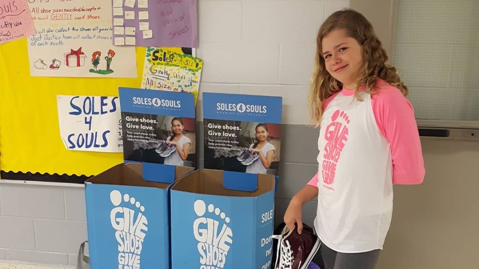 May Reiter-Lee is seen at one of her shoe drive locations.