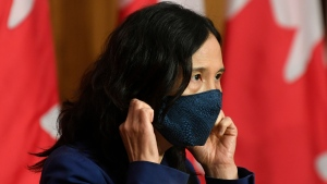 Chief Public Health Officer Theresa Tam removes her mask as she arrives for a news conference Friday, October 2, 2020 in Ottawa. THE CANADIAN PRESS/Adrian Wyld