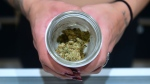 "A jar of Insane OG, a strain of marijuana, is displayed at the opening of ""Dr. Greenthumb,"" the flagship medical and recreational marijuana dispensary in California. (Frederic J. Brown/AFP/GettyImages/CNN)"