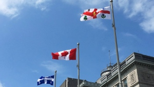 Flags fly outside of Montreal City Hall on Thursday, June 7, 2018. THE CANADIAN PRESS/Sidhartha Banerjee