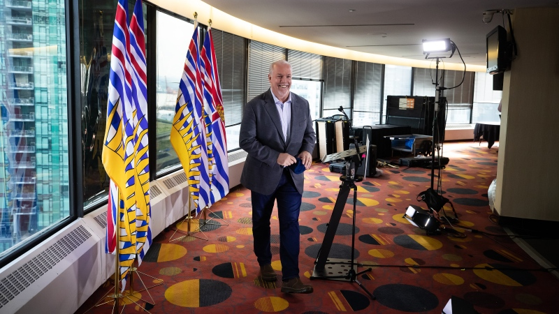 B.C. Premier-elect John Horgan smiles as he leaves after a post-election news conference, in Vancouver, on Sunday, Oct. 25, 2020. (Darryl Dyck / THE CANADIAN PRESS)