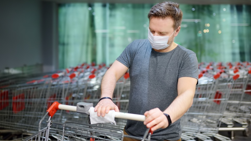 Man cleans shopping cart in this undated image. (Shutterstock)