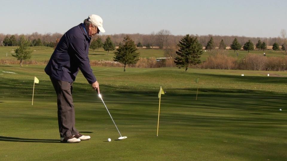 Man getting ready to tee off at Fox Golf Club