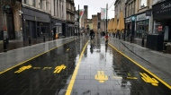 A view of a quiet street in Cardiff, Wales, Sunday, Oct. 25, 2020. The Welsh government have imposed one of the U.K.'s strictest lockdowns, including a ban on non-essential travel. Wales also closed most businesses and restricted high schools to online instruction. (Ben Birchall/PA via AP)