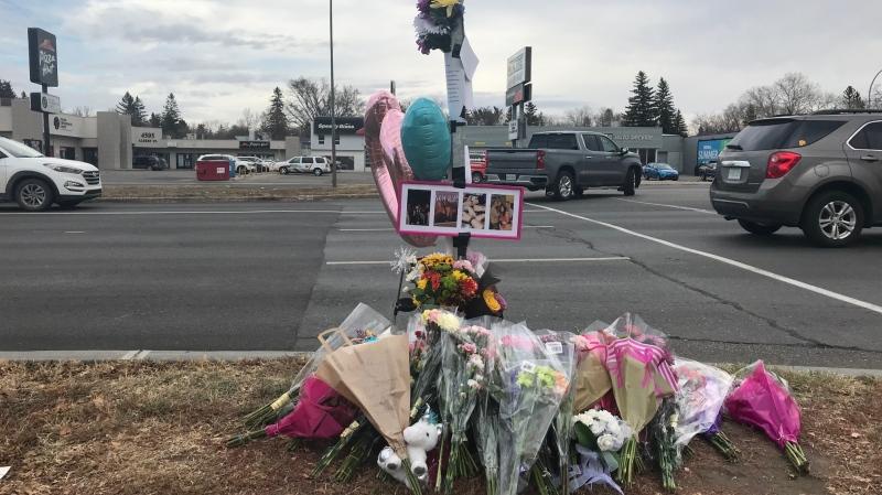 A roadside memorial sits near an Albert St. crosswalk where a woman was fatally struck by a vehicle on Wednesday morning. (Stefanie Davis/CTV News)