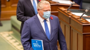 Ontario Premier Doug Ford carries the Ontario Budget as he arrives in the Ontario Legislature in Toronto on Thursday November 5, 2020. THE CANADIAN PRESS/Frank Gunn