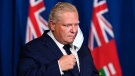 Ontario Premier Doug Ford arrives at a press conference at Queen's Park during the COVID-19 pandemic in Toronto on Tuesday, November 3, 2020. The provincial government unveiled a new tiered system for COVID-19 restrictions that will give municipalities and public health units guidelines for when to implement lockdows and closures. (THE CANADIAN PRESS/Nathan Denette)