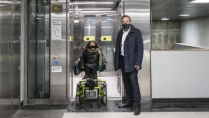 Laurence Parent, Paratransit users' representative, and Philippe Schnobb, chairman of the STM's Board of directors unveil the new elevator at Berri-UQAM metro station. SOURCE: STM