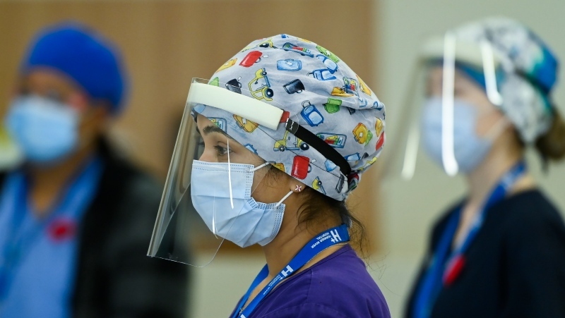 Respiratory registered nurse Angeline Kurian, who works on a COVID-19 floor, wears personal protective equipment as she has a coffee break at the Humber River Hospital during the COVID-19 pandemic in Toronto on Thursday, November 5, 2020. THE CANADIAN PRESS/Nathan Denette