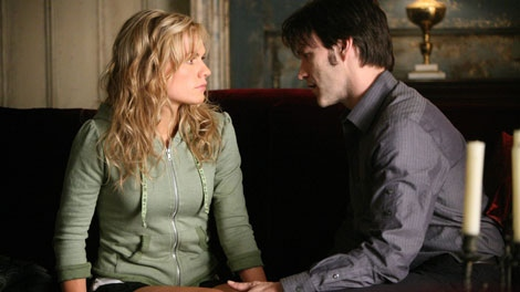 In this image released by HBO, Anna Paquin, left, and Stephen Moyer are shown in a scene from the second season of the HBO original series, 'True Blood' (AP / HBO, Jaimie Trueblood)
