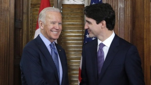 FILE- Prime Minister Justin Trudeau shakes hands with US Vice-President Joe Biden on Parliament Hill in Ottawa on Friday, December 9, 2016. Trudeau and Biden spoke on the phone Friday. THE CANADIAN PRESS/Patrick Doyle