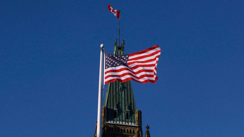 The US flag flies in front of the Peace Tower on Parliament Hill before the arrival of then-U.S. vice president Joe Biden in Ottawa on Friday, December 9, 2016. THE CANADIAN PRESS/ Patrick Doyle