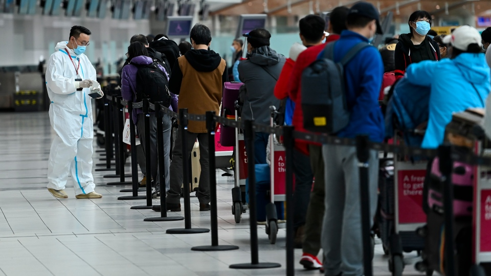 People line up and check in for an international flight at Pearson International airport during the COVID-19 pandemic in Toronto on Wednesday, Oct. 14, 2020. (THE CANADIAN PRESS / Nathan Denette)