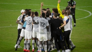 The Montreal Impact celebrates a win over D.C. United in an MLS soccer game Sunday, Nov. 8, 2020, in Washington. (Katherine Frey/The Washington Post via AP)