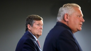 Toronto Mayor John Tory looks on at Ontario Premier Doug Ford as the two levels of government speak to media on Toronto, Friday, Aug. 23, 2019. THE CANADIAN PRESS/Cole Burston