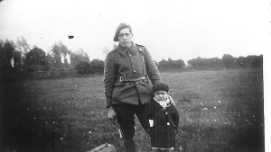 Child Marcel Pinte with an unidentified Resistance fighter. (Courtesy of the Bremaud family via AP)
