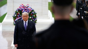 U.S. President Donald Trump participates in a Veterans Day wreath laying ceremony at the Tomb of the Unknown Soldier at Arlington National Cemetery, on Nov. 11, 2020. (Patrick Semansky / AP)