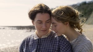 "This image released by Neon shows Kate Winslet, left, and Saoirse Ronan in a scene from ""Ammonite."" (Neon via AP)"
