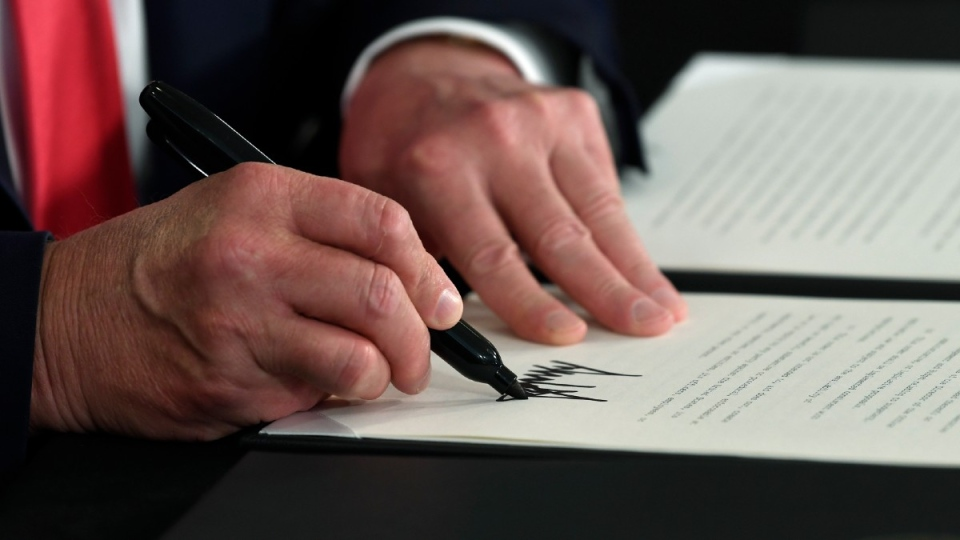 U.S. President Trump signs an executive order