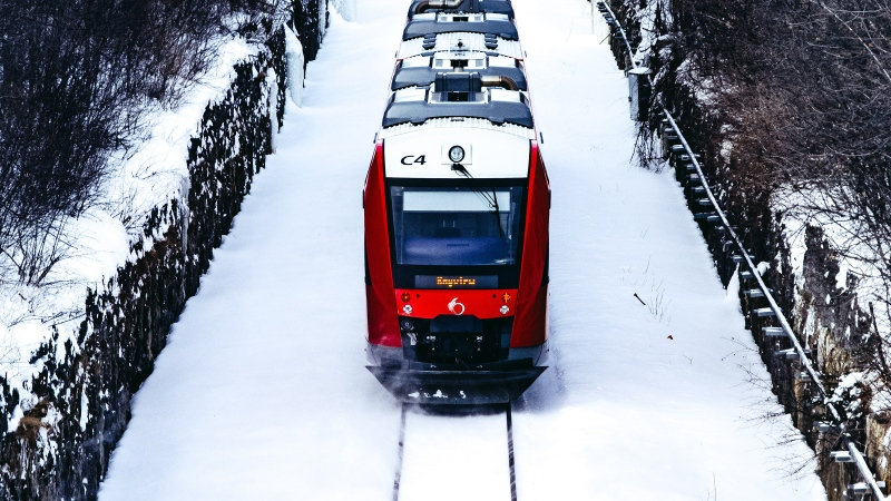 The O-Train travels on snow covered tracks along the Trillium Line in Ottawa. (Photo by Sebastien Artaud of Unsplash)