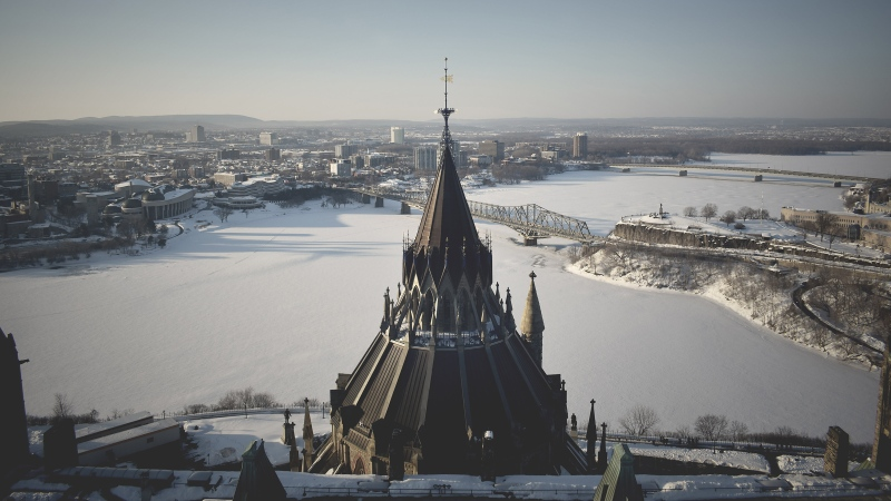 Library at Parliament Hill from above, overlooking the Ottawa River on winter's day. (Photo by SGC on Unsplash)