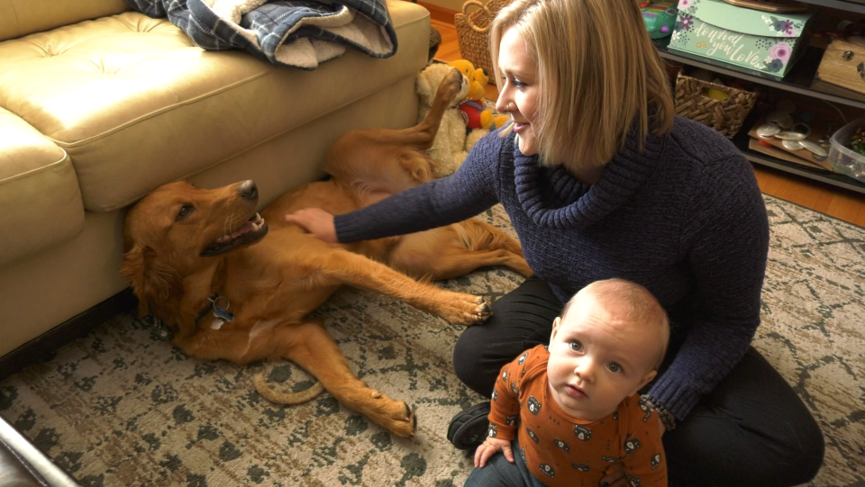 Julia Neufeldt spends time with her dog Louie and son Owen (Chad Leroux/CTV Saskatoon)