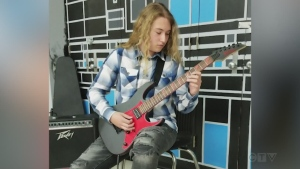 Grade 10 student Randy Desormeaux from Sudbury shows his guitar skills on a song by Joe Satriani.