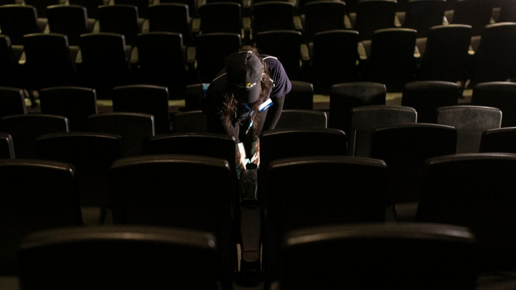 Cleaning seats at a Cineplex movie theatre