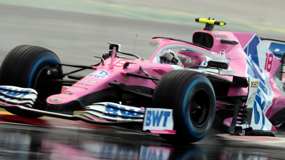 Racing Point driver Lance Stroll of Canada steers his car during the qualifying session at the Istanbul Park circuit racetrack in Istanbul, Saturday, Nov. 14, 2020. The Formula One Turkish Grand Prix will take place on Sunday. (Tolga Bozoglu / Pool via AP)