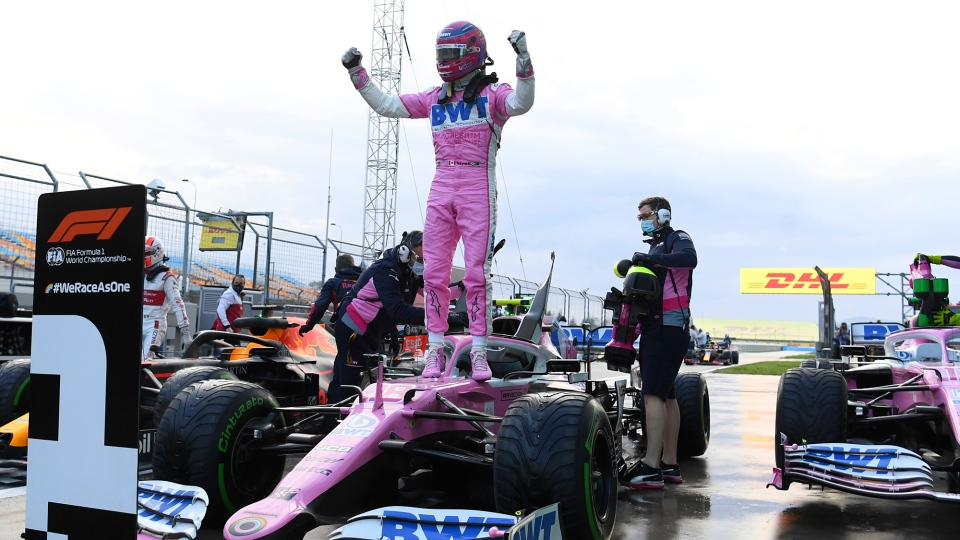 Racing Point driver Lance Stroll of Canada celebrates his pole position after the qualifying session at the Istanbul Park circuit racetrack in Istanbul, Saturday, Nov. 14, 2020. The Formula One Turkish Grand Prix will take place on Sunday. (Clive Mason / Pool via AP)