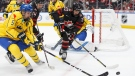 Canada's Dylan Holloway (20) battles against Sweden's Alexander Lundqvist (5) during first period Hlinka Gretzky Cup gold medal game action in Edmonton on Saturday, August 11, 2018. THE CANADIAN PRESS/Codie McLachlan