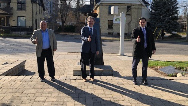 From left to right, Farhi Corp. Shmuel Farhi, Banting Curator Grant Maltman, MP Peter Fragiskatos, in front of the Flame of Hope, seen on Saturday November 14, 2020 (Nick Paparella / CTV News)