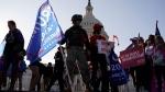 Supporters of U.S. President Donald Trump attend pro-Trump marches, Saturday Nov. 14, 2020, in Washington. (AP / Jacquelyn Martin)