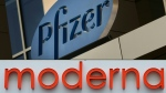 This combination of file pictures shows signs for the Pfizer and Moderna pharmaceutical companies, both in Cambridge, Mass. (AFP)