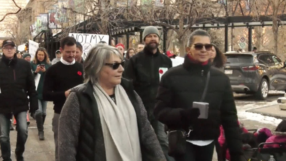 Participants marched through Olympic Plaza during Sunday's anti-shutdown protest in downtown Calgary