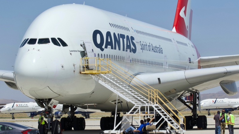 A Qantas Airbus A380 arrives at Southern California Logistics Airport in Victorville, Calif., Monday, July 6, 2020. (AP Photo/Matt Hartman)