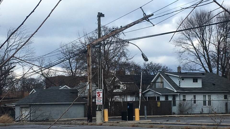 A hydro pole split in half on Goyeau Street in Windsor, Ont., on Sunday, Nov. 15, 2020. (Bob Bellacicco / CTV Windsor)