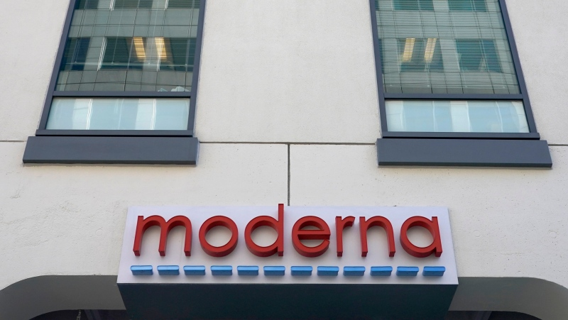The sign for Moderna, Inc. hangs on its headquarters on Tuesday, Dec. 15, 2020, in Cambridge, Mass.  (AP Photo/Elise Amendola, File)